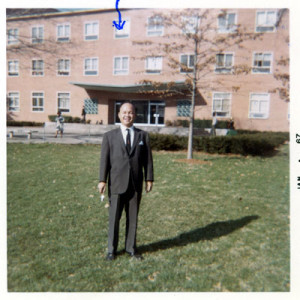 Rosendo posing in front of his office (blue arrow) at Howard University.